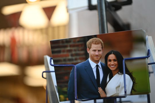Royal memorabilia featuring Prince Harry and Duchess Meghan of Sussex for sale near Buckingham Palace   on Jan. 10, 2020.