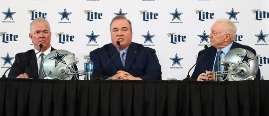 Mike McCarthy answers questions as he is flanked by owner Jerry Jones (right) and executive vice president Stephen Jones during a press conference at Ford Center at the Star.