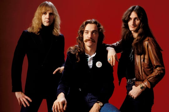Circa 1978 photo of themembers of the musical group Rush: Alex Lifeson, left, Neil Peart and Geddy Lee. CREDIT: Fin Costello, Redferns via Getty  ORG XMIT: 163687912 ORIG FILE ID: 84884031