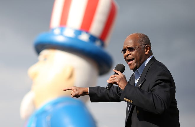 Former Republican presidential candidate Herman Cain speaks during an American For Prosperity rally on July 23, 2012 in Reno, Nevada. Hundreds of people attended an Americans For Prosperity rally to see former Republican presidential candidate speak.