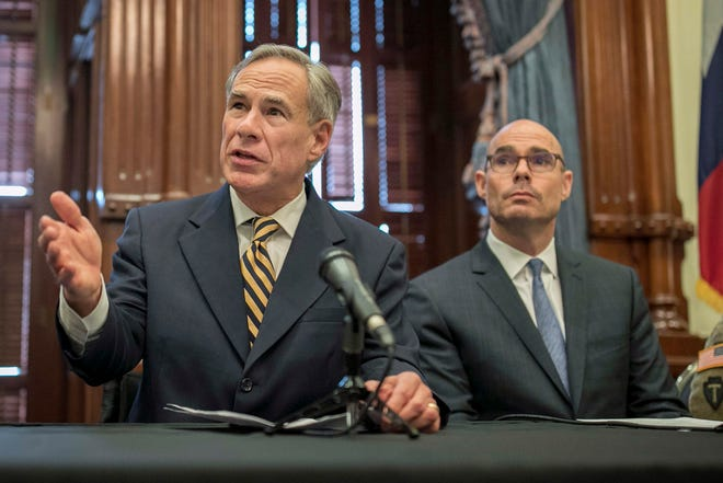 In this June 21, 2019 file photo, Gov. Greg Abbott, left, speaks at a news conference at the Capitol, in Austin, Texas. Abbott says the state will reject the re-settlement of new refugees.