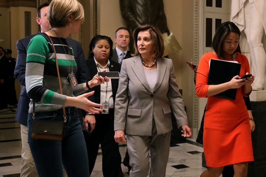 House Speaker Nancy Pelosi, D-Calif., answers questions from reporters as she leaves the House chamber on Jan. 10, 2020.