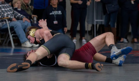 Point Pleasant Boro's Gavin O'Connor pancakes Lacey's Logan Carter for the winning takedown with two seconds left of the 170-pound bout. Point Boro won the match 32-25.
