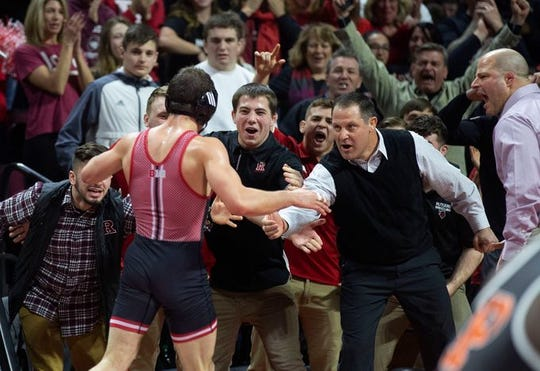 Rutgers' head wrestling coach Scott Goodale, shown congratulating 2019 NCAA 149-pound champion Anthony Ashnault last season after Ashnault's big regular season win over Princeton's Matthew Kolodzik, said after the Scarlet Knights' 22-13 loss at Ohio State Friday night that Rutgers needs to start beating national powerhouse programs like Ohio State.