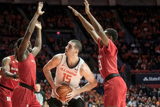 Illinois' Giorgi Bezhanishvili (15) looks for an open shot as he is pressured by Rutgers' Akwasi Yeboah (1) and Montez Mathis
