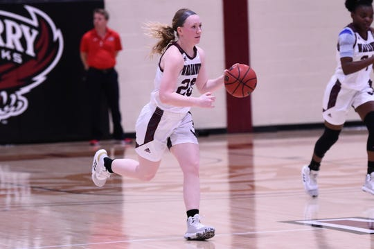 McMurry's Sarah Doherty (20) brings the ball down the court against Sul Ross State at Kimbrell Arena on Saturday. Doherty played point guard her sophomore and junior seasons before moving back to shooting guard this season as a senior.