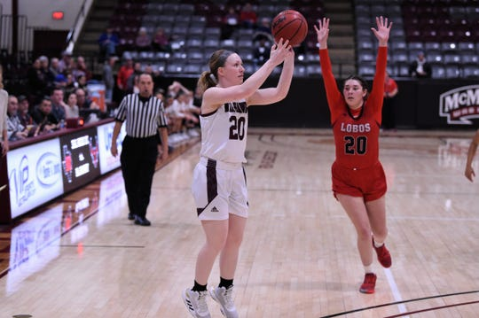 McMurry's Sarah Doherty (20) shoots a 3-pointer against Sul Ross State at Kimbrell Arena on Saturday. Doherty has made 28 3s in 12 games this season for the War Hawks.