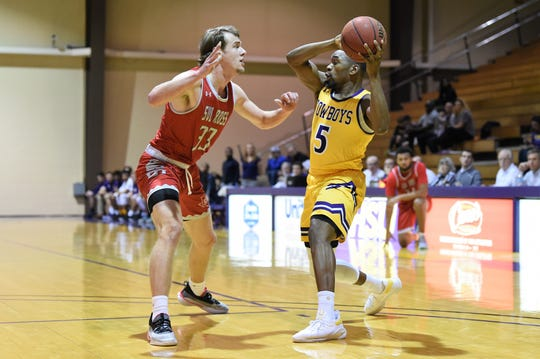 HSU guard Keenan Holdman (5) looks to make a pass against Sul Ross State at the Mabee Complex last week. The Cowboys lost their first three conference games, but with a big win against Howard Payne on Saturday are trying to turn things around.