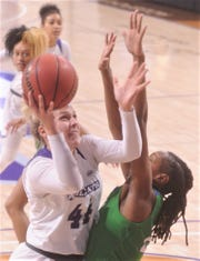 ACU's Lexie Ducat (44) drives against a Texas A&M-Corpus Christi defender in the first quarter of the Southland Conference game Saturday, Jan. 11, 2020, at Moody Coliseum.
