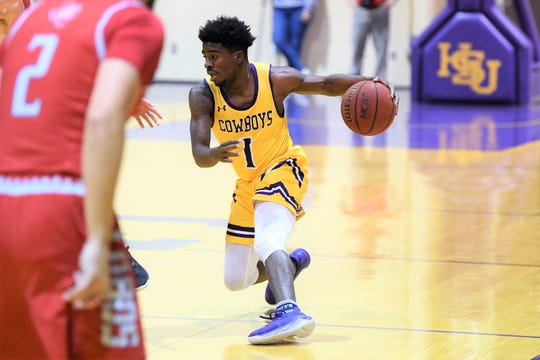 Hardin-Simmons guard Chris Barrett (1) makes a move with the ball against Sul Ross State last week. Barrett joined the Cowboys after a year at East Texas Baptist.