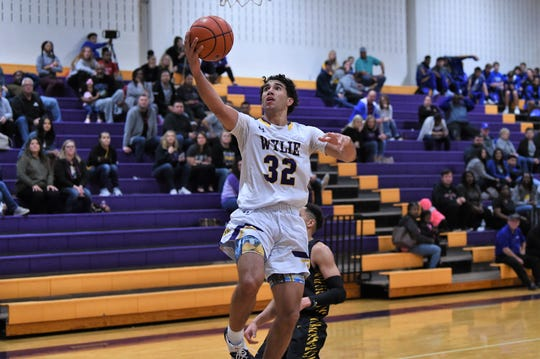 Wylie's Payton Brooks (32) lays the ball in against Wolfforth Frenship at Bulldog Gym on Friday, Jan. 10, 2020. The Bulldogs fell 62-41.