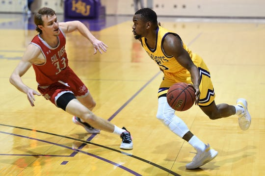 HSU guard Keenan Holdman (5) makes a move towards the basket against Sul Ross State last week. Holdman came in as a transfer from Mary Hardin-Baylor after his freshman season.