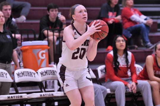 McMurry's Sarah Doherty (20) shoots a 3-pointer against Sul Ross State at Kimbrell Arena on Saturday. Doherty knocked down three 3s as the War Hawks won 87-82.