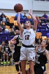 Wylie's Karis Christian (12) puts up a shot against No. 12 Wichita Falls Rider on Friday. The Lady Raiders took the District 4-5A opener 48-30.