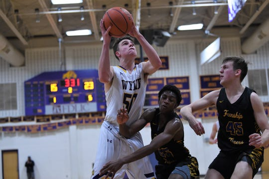 Wylie's Avery Brekke (50) battles through contact for a shot against Wolfforth Frenship at Bulldog Gym on Friday, Jan. 10, 2020. The Bulldogs fell 62-41.