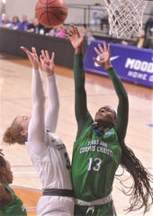 ACU's Madi Miller, left, shoots over Texas A&M-Corpus Christi's Alecia Westbrook during the first quarter of the Southland Conference game Saturday, Jan. 11, 2020, at Moody Coliseum.