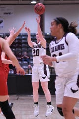 McMurry's Sarah Doherty (20) lets go of a 3-point shot against Sul Ross State on Saturday. The War Hawks won 87-82.