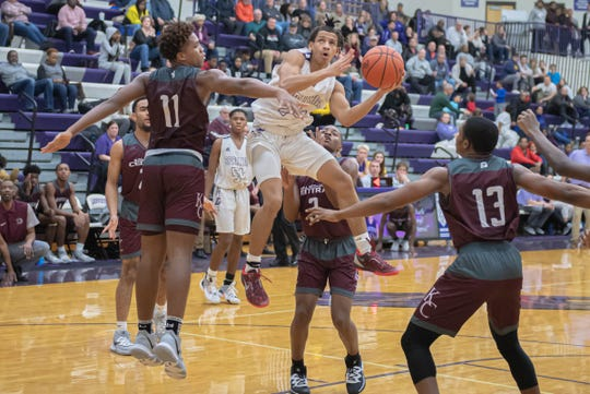 Lakeview's Tommy Moore III (24) looks for the hoop while being surrounded by a trio of Kalamazoo Central defenders during second quarter action on January 10, 2020.