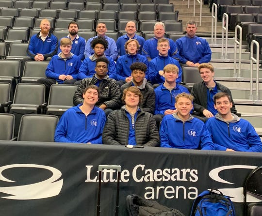 The Harper Creek boys basketball team hangs out in the stands at Little Caesars Arena before their game as part of the 'Court of Dreams' contest with Hastings on Saturday.