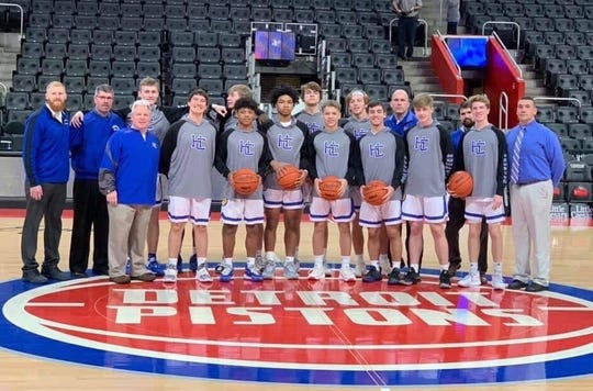 The Harper Creek boys basketball team takes center court at Little Caesars Arena before their game as part of the 'Court of Dreams' contest with Hastings on Saturday.
