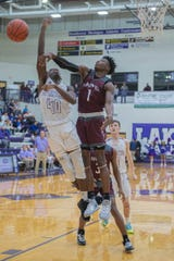 Kalamazoo Central's Jayvion Henry (1) gets the block over Lakeview's Frank Tatum III (40) during second quarter action on January 10, 2020.