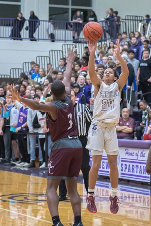 Lakeview's Tommy Moore, III (24) takes a jump shot while being guarded by Kalamazoo Central's Scott Hughes (3) during second quarter action on January 10, 2020.