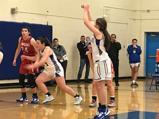 Maine-Endwell's Kaetlyn L'Amoreaux releases a free throw as Owego's Evee Coleman (24) and M-E's Amanda DeSantis battle for position in the fourth quarter of Friday's Southern Tier Athletic Conference game at M-E. L'Amoreaux had 17 points in the Spartans' 62-57 victory.
