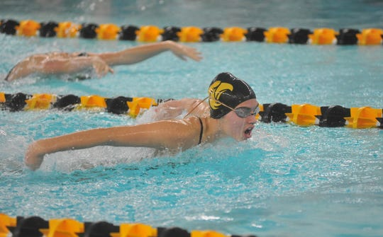 Colonel Crawford's Cassidy Vogt swims the 100 fly with teammate Emma Swisher in the lane above.