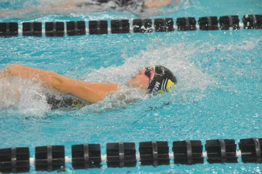 Colonel Crawford's Abby Martin swims the 100 backstroke.