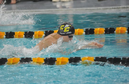 Colonel Crawford's Branyan Rowland swims the 100 breaststroke.