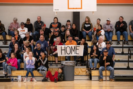 Members of the Refugio community watch the girls basketball play the first varsity game in the school's new gym on Friday, Jan. 10, 2020. Refugio's old gym was damaged by Hurricane Harvey in 2017.
