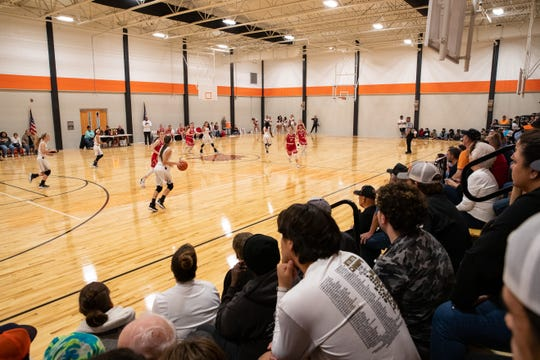 Members of the Refugio community watch the girls basketball team play in the first varsity game in the school's new gym on Friday, Jan. 10, 2020. Refugio's old gym was damaged by Hurricane Harvey in 2017.