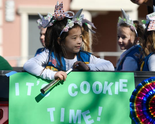 Six-year-old Adelyn Tadtaotao sits in the Girl Scout float at the 85th Annual Nueces County Junior Livestock Show Parade, Saturday, Jan. 11, 2020, in Robstown. Tadtaotao is from Calallen.