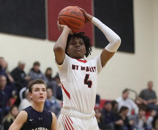 Mt. Healthy guard Kyle Tolbert (4) shoots the ball during their basketball game against Edgewood, Friday, Jan. 10, 2020.