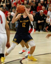 Moeller guard Will McCracken looks to pass in the boys basketball game between Moeller and La Salle High School Jan. 10, 2020. Moeller defeated La Salle 45-43.