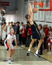 Moeller forward Logan Duncomb dunks in the boys basketball game between Moeller and La Salle High School Jan. 10, 2020. Moeller defeated La Salle 45-43.