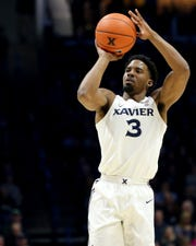 Xavier Musketeers guard Quentin Goodin (3) rises for a shot during the first half of an NCAA men's basketball game against the Creighton Bluejays, Saturday, Jan. 11, 2020, at Cintas Center in Cincinnati.
