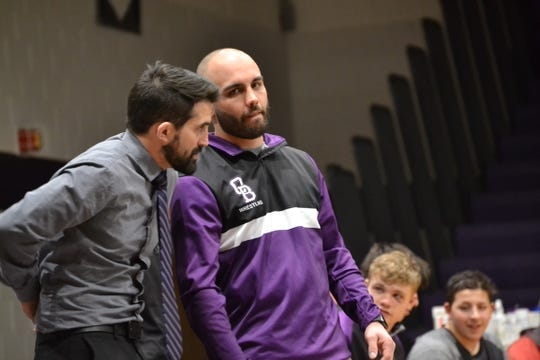 Old Bridge head coach John Post takes in Wednesday's dual meet action along with assistant coach Josh Baker.