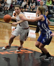 Ridgewood's Kalie Rettos drives towards the hoop against a Buckeye Trail defender. Rettos will also head to Heidelberg, playing for the women's basketball program.