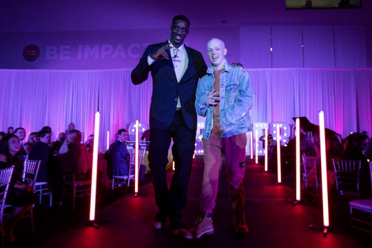 Detroit Pistons player Tony Snell poses on stage with Tommy Schomaker during the Runway of Hopes and Dreams at the Detroit Pistons Performance Center in Detroit, Friday, Jan. 10, 2020.