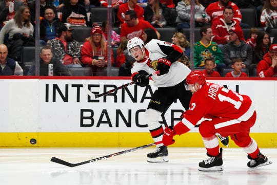 Ottawa Senators right wing Drake Batherson takes a shot defended by Detroit Red Wings defenseman Filip Hronek in the third period at Little Caesars Arena, Jan. 10, 2020.