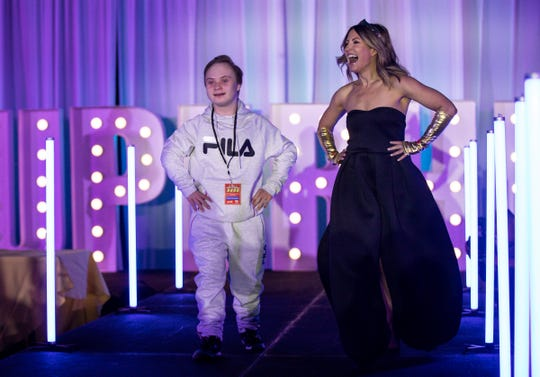 Michael Banaszewski walks on stage with Shannon Murphy during the Runway of Hopes and Dreams at the Detroit Pistons Performance Center in Detroit, Friday, Jan. 10, 2020.