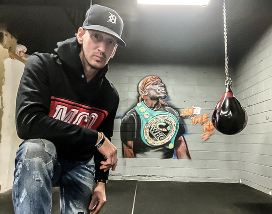 Scotty Buchzeiger, a former professional boxer from Detroit, is working to raise the profile of local boxers and the sport in Metro Detroit. Shown at Tony Harrison's gym in Detroit.