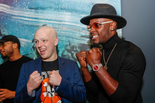 Tommy Schomaker, left, talks to Detroit boxer Tony Harrison during the Runway of Hopes and Dreams at the Detroit Pistons Performance Center in Detroit, Friday, Jan. 10, 2020.