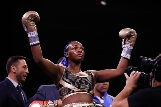 Claressa Shields stands for her introduction for a fight with Ivana Habazin in a women's 154-pound title boxing bout in Atlantic City, N.J., Friday, Jan. 10, 2020.