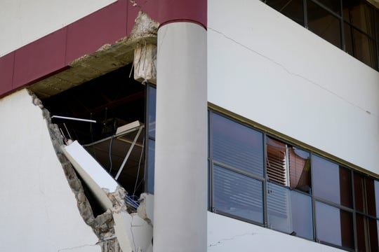 A municipal building is damaged after a magnitude 5.9 earthquake in Guanica, Puerto Rico, Saturday, Jan. 11, 2020.   ​