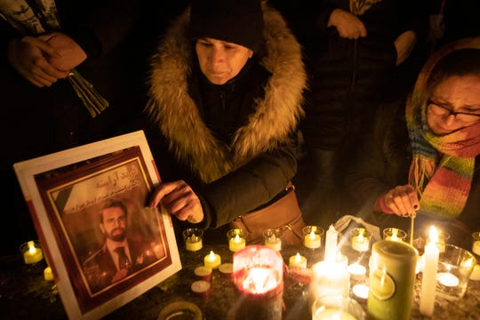 A photograph is placed at a memorial during a vigil in Toronto, Thursday, Jan. 9, 2020, to remember the victims of the civilian Ukrainian jetliner that crashed near Tehran late Tuesday, killing all 176 people on board.