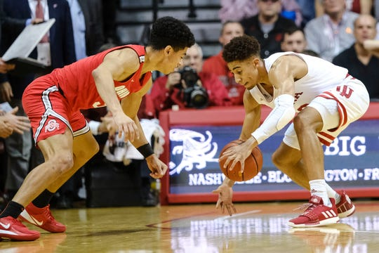 Indiana guard Rob Phinisee, right, steals the ball from Ohio State guard D.J. Carton during the first half.