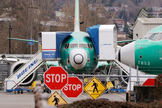 FILE - In this Monday, Dec. 16, 2019, file photo, Boeing 737 Max jets sit parked in Renton, Wash. Newly released Boeing documents show that company employees knew about problems with flight simulators for the now-grounded 737 Max jetliner and talked about misleading regulators.