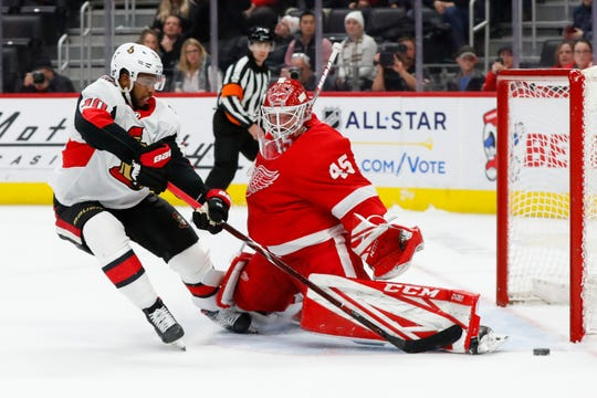 Detroit Red Wings goaltender Jonathan Bernier (45) stops Ottawa Senators left wing Anthony Duclair (10) during a shootout.